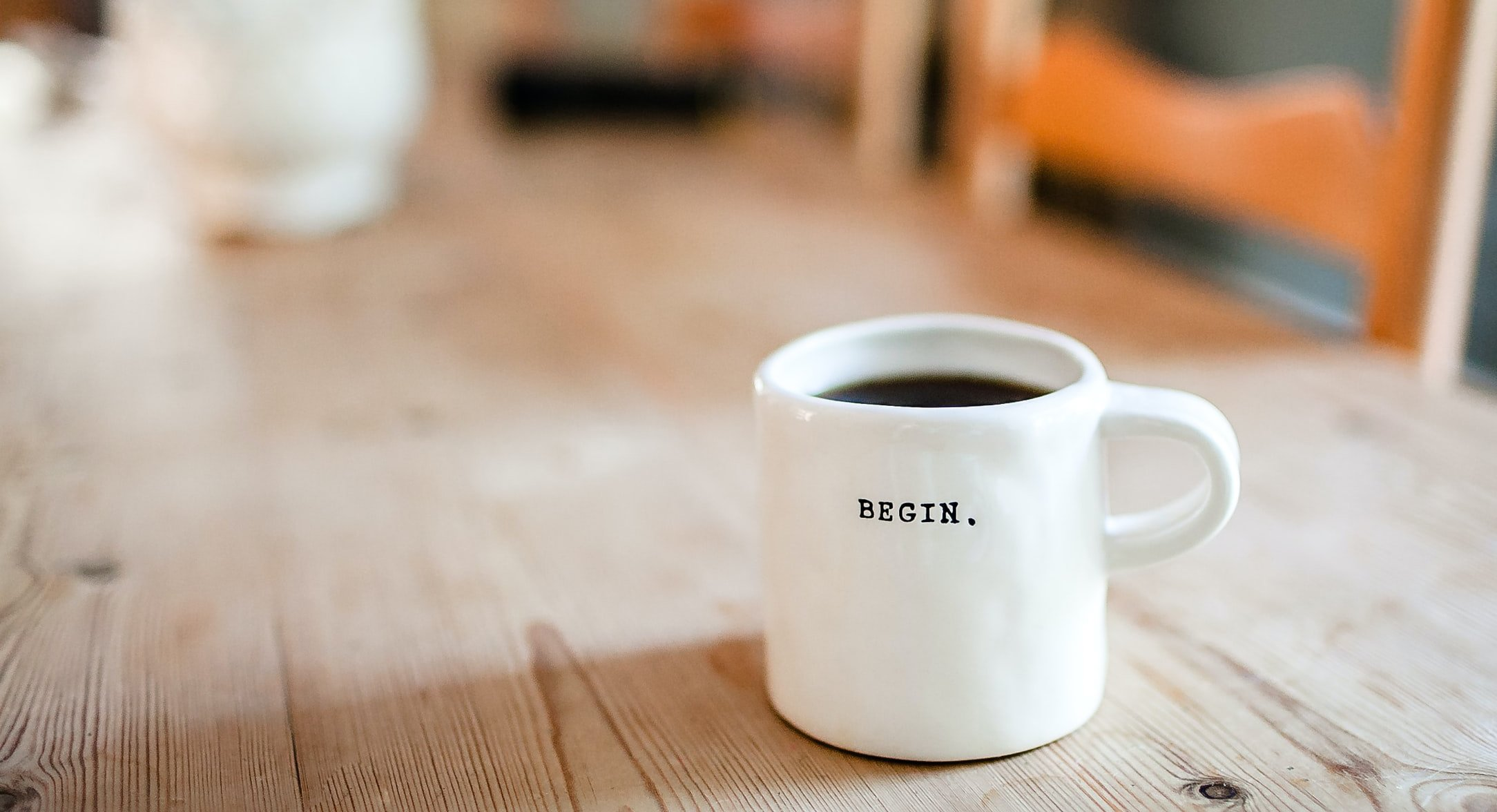Coffee mug with 'begin'
